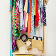 Wardrobe with summer clothes nicely arranged. — Stock Photo #48439993