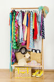 Wardrobe with summer clothes nicely arranged. — Stock Photo