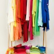 Wardrobe with summer clothes nicely arranged. — Stock Photo #48440005