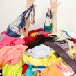 Man hands reaching out from a big pile of clothes and accessories. — Stock Photo #48440023