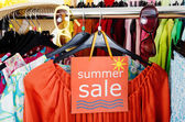 Close up on a big sale sign for summer clothes. — Stock Photo