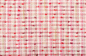 Tartan print as background. Pink woven with threads plaid pattern. — Stock Photo