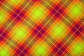 Tartan pattern. Neon green with orange and red plaid print as background. — Stock Photo