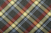 Tartan pattern. Grey with yellow and red plaid print as background. — Stock Photo