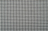 Symmetric square check tablecloth pattern. Black and white little square design as background. — Stock Photo