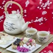 Chinese tradition candy with tea — Stock Photo