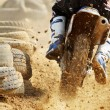Stock Photo: Motocross bike increase speed in track