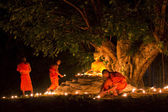 Buddhist monk fire candles — Stock Photo