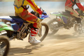 Motocross bikes racing in track — Stok fotoğraf