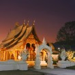 Laos wooden temple in sunset — Stock Photo #12459225