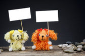 Dolls dog holding a placard — Stock Photo