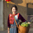 Lisu Hill tribe girl in traditional costume with her vegetable f — Stock Photo