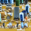 Electronic components on circuit — Stock Photo