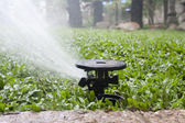 Sprinkler watering the grass — Stock Photo