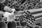 Worker cut pvc pipe in construction site — Zdjęcie stockowe