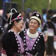 Hmong Hill Tribe women in traditional costumes - Stock Photo