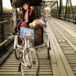 Lisu Hill tribe flower street vender on tricycle bike taxi — Stock Photo
