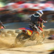 Motocross bike increase speed in track — Stock Photo #12725545