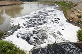 Water pollution in river — Stockfoto