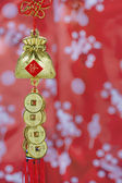 Chinese Lucky Knot on red background — Stock Photo