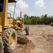 Motor grader working on road construction — Stock Photo