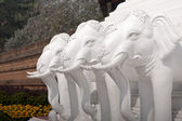Tree white elephants sculpture — Stock Photo