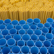 Yellow and blue pvc pipes — Stock Photo #13595089