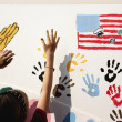Painting American flag on wall — Stock Photo