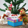 Stock Photo: Snowman With Christmas Gift