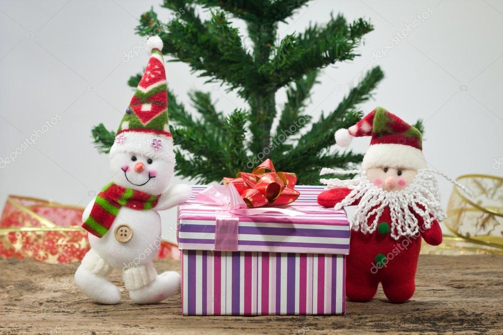 Christmas gift with snowman and santa. — Stock Photo #15320145