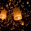 Floating asian lanterns - Stock Photo