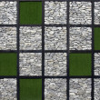 Stock Photo: Artificial grass and stone pattern wall.