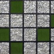 Artificial grass and stone pattern wall. — Stock Photo