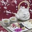 Chinese tradition candy with tea — Stock Photo #18777287