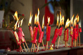 Red candles in chinese temple — Stock Photo