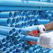 Stock Photo: Worker cut pvc pipe in construction site
