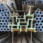 Metal pipe and I-beam — Stock Photo