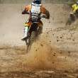 Motocross bike increase speed in track — Stock Photo #27254195