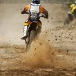 Motocross bike increase speed in track — Stock Photo