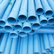 Stock Photo: PVC pipes staked in construction site