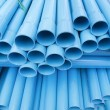 PVC pipes staked in construction site — Stock Photo #30674709