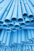 PVC pipes staked in construction site — Stock Photo