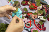 Hand sewing elephant cloth dolls — Stock Photo