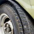 Blowout tire of old car — Stock Photo