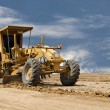 Stock Photo: Motor grader working on road construction