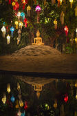 Buddha statue with lanterns on tree in the temple , — Stock Photo