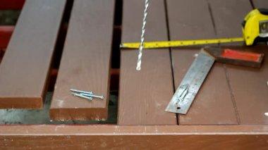 Worker installing artificial wood floor for patio — Stock Video