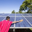 Stock Photo: Karen hill tribe cleaning solar panel .Thailand
