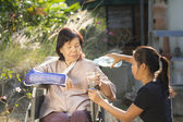 Young asian is taking care the senior woman — Stock Photo