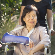 Asian senior woman with broken wrist on wheel chair — Stock Photo